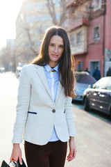 Young businesswoman standing on the street.