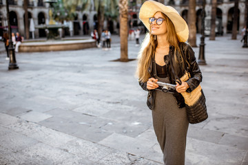 Young woman tourist walking on the reila square in Barcelona city