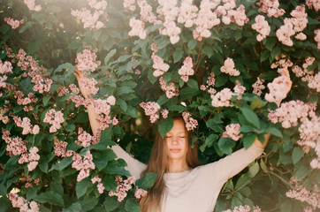 Woman under lilacs