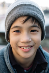 Portrait of a 10 year old boy smiling and looking at camera