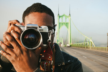 Man taking picture with a vintage film camera