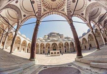 Wide angle fisheye exterior shot of an inner court yard of the biggest Suleymaniye mosque in Istanbul