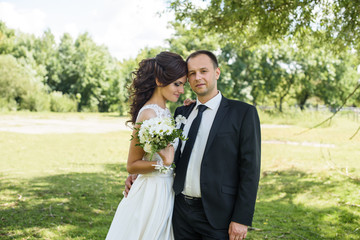 Portrait of a young couple. Wedding photo outdoor of loving couple