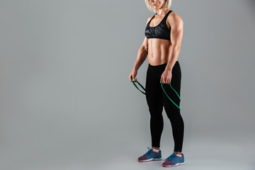 Cropped image of a fit muscular adult sportswoman