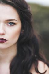 Beautiful woman, half face portrait