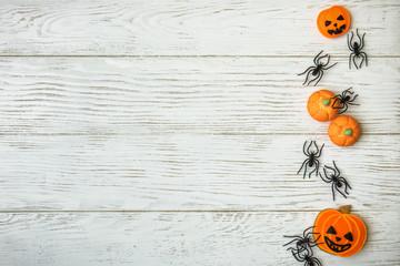 Halloween background with pumpkin cookies