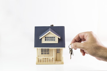 Buying new real estate concept, house and key on hand. Protect Your Home Concept