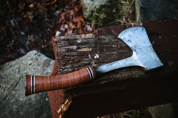 Sharp hatchet hand tool on old wood