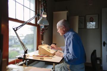 Senior Man Painting in Home Studio