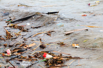 Pollution Problem - plastic, containers and other debris polluting the ocean and beach