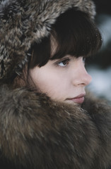 winter close-up of the young woman .