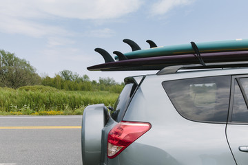 Paddleboards on Roof Rack of Automobile