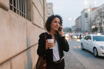Young woman on the phone in the business district