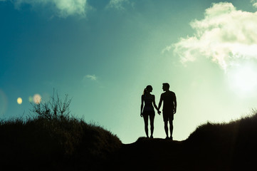 People, love, relationships. Couple holding hands walking together on country road.