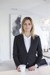 Portrait of businesswoman in black suitjacket