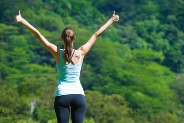 Happy active woman in a green nature setting.