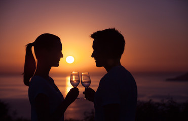 Romantic date by the sea with wine and sunset view