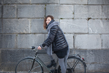 Pretty Young Woman With Bike . Portrait