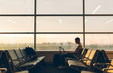 Man Waiting for His Flight on an Empty Gate