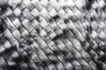 Metallic silver paint covering chain-link fence