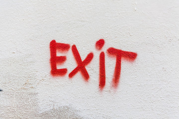 Exit Graffiti on White Plaster Wall