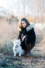 Beautiful woman with her small white dog