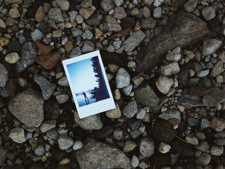 Instant picture sitting on a Pebbled Beach