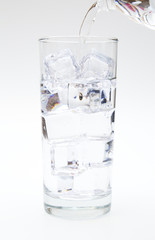 Water Being Poured into a Glass of Ice