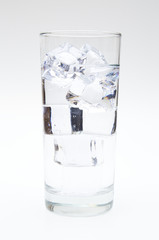Glass of Ice Water on a White Background