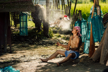 Rural farmer with chicken at countryside,Thailand.The lifestyle of farmer and chickens is a pet in farmland.
