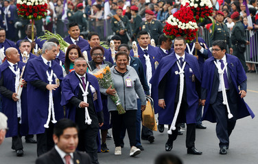 Petronila Gonzalez, Dona Peta, (C) mother of Peru's soccer star Paolo Guerrero attends the procession of Senor de Los Milagros ( Lord of Miracles ), Peru's most revered Catholic religious icon, in downtown Lima,