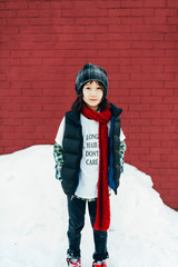 Young mixed race boy in snow