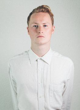 Elegant blonde man in white shirt.