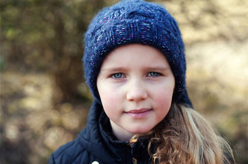 Young girl in a blue woollen hat