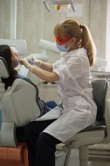 Dentist curing patient