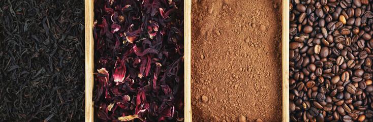 Grains of coffee, cocoa powder, karkade and black tea in a box, panorama.