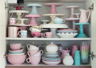 Kitchen cupboard filled with crockery