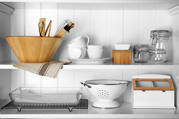 Storage stand with cooking utensils indoors
