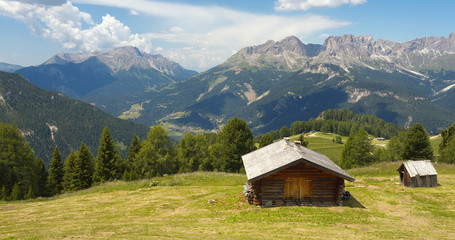 Woody cabin and Dolomites, Italy