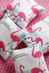 Cushions with flamingos on pink background