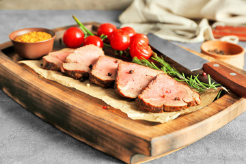 Wall Mural - Sliced tasty steak on wooden board
