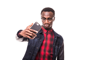 Smiling african american young man making selfie on white background