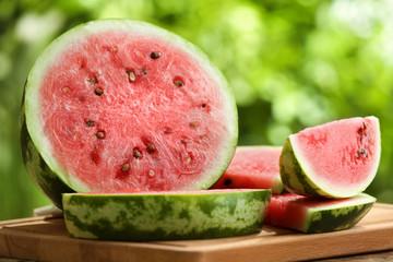 Tasty sliced watermelon on table outdoors