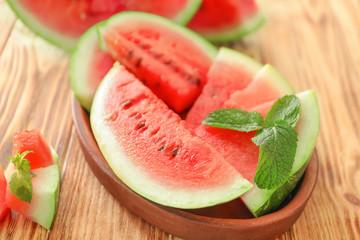 Tasty sliced watermelon on wooden table