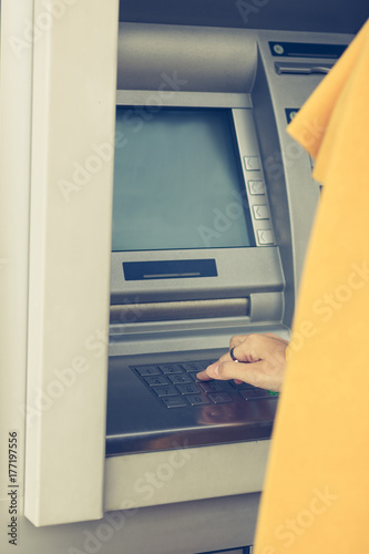 Typing PIN code on ATM machine