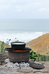 Open flame cooking by the sea