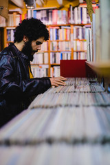 Male diggin for vinyls in an antique record store