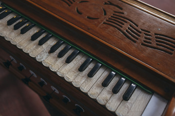 Close up of harmonium keys from above.