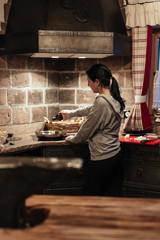 woman cooking in cast iron kitchen