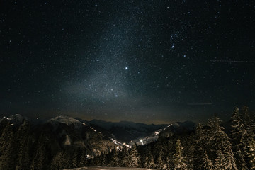 alpine austrian winter landscape under starry night with the milky way